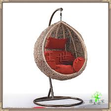 Captivating Rattan Chair With Orange Pillows