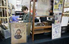 old photographs that are being sold by vendor oldpaperpicker of akron during the 35th akron antiquarian book paper show at the john s knight center