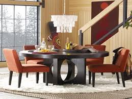 modern and luxurious dining e with chandelier and wooden round kitchen table set with red chairs
