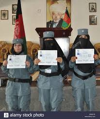 three female police officers the afghan uniform police stock photo three female police officers the afghan uniform police display their diplomas after graduating from the aup academy at sharan hall