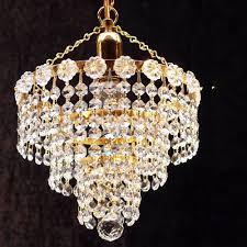 fantastic lighting 3 tier chandelier kp 8 1 with crystal strands ceiling light