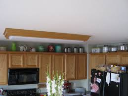 Above Kitchen Cabinet Above Kitchen Cabinet Decor Classic White Wooden Kitchen Island