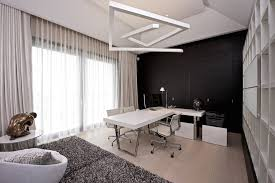 black cupboard with white wall office design black and white office design