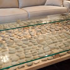 nicaraguan cedro macho wood and hand placed coastal stones under two floating glass tops we could stare at this all day decor coffeetable zen