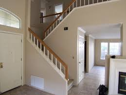 this 1990s track home had 18 high walls with a short iron railing on top we removed the old railing cut down the walls to the tops of the kickboards