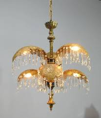 an unusual italian brass chandelier chandelier has six palm frond style arms with hanging crystal