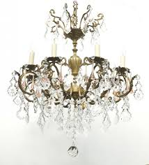 large 8 light italian antique brass chandelier with flower patterned crystal leaves crystal swags and