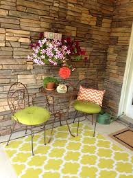 front porch with painted rug on concrete
