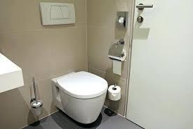 hiding plumbing access with wainscoting door studs panel ideas