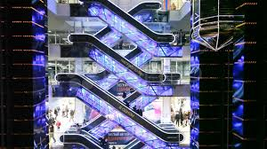 people on escalators. people on escalators in evropeisky mall moscow, russia. ~ footage #993023 a