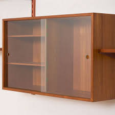 teak with glass sliding door cabinet