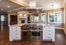kitchen appliances are stainless steel by jennair castle rock builder spec home with island subway tile and farm sink