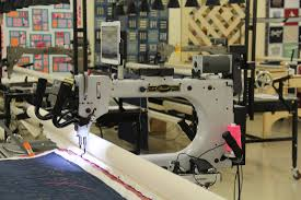 Used Longarm Quilting Machines - Accomplish Quilting & 12' sit or stand pivotal access frame, fabric roller wheels, poly table top,  swivel casters, and Quick Zip System. Adamdwight.com