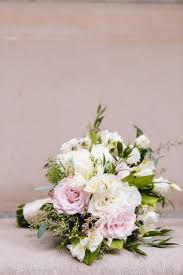 jewish ceremony reception touches of 1920s glam in atlanta loosely structured blush and ivory wedding bouquet greenery rose flowers