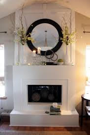 decorating fireplace mantel mirror branches