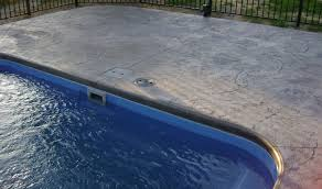 stamped concrete pool patio. Pool Patio Materials: Stamped Concrete Vs. Pavers