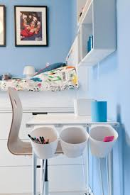 Side view of Children's Ikea Hack Desk Tidy. Desk and chair in front of bed