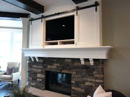 modern tv above fireplace design ideas best on over full size of mantle corner with idea tv over