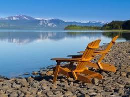 adirondack chairs lake. Wonderful Chairs Stock Photo  Two Empty Wooden Adirondack Chairs Or Muskoka Deckchairs On  Stony Shore Overlooking Scenic Calm Lake Laberge Yukon Territory Canada  Throughout Chairs S