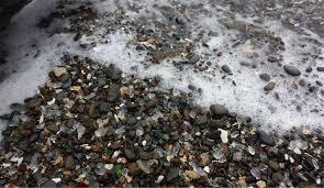 pacific ocean washing sea glass onto glass beach fort bragg