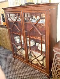 mahogany 2 door bookcase heavy inlay of roman key border and chain link around