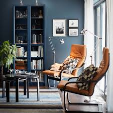 glass door cabinets living room. a small livingroom furnished with two armchairs natural-coloured leather cushions and black- · bookcase glass-doors glass door cabinets living room