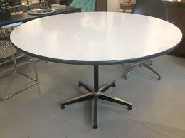 vintage round dining table designed by charles ray eames for herman miller in 1964 aluminum base black column finish white veneer top with black vinyl