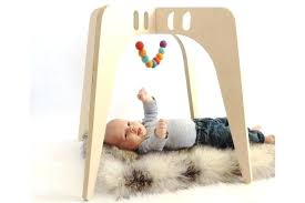 wooden baby gym tutorial 3 beautiful fun wooden baby play gyms cool mom picks diy wooden wooden baby gym