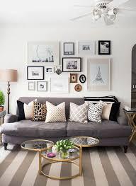 art living room. living room pale grey sofa ter cushions pastel painting artwork black reading · there art