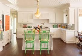 traditional white kitchen wiht yellow door knobs and quartz countertop