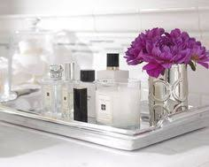 Bathroom Vanity Tray Decor The silver tray with the glass containers look lovely Could be used 19
