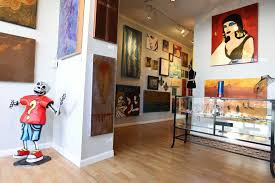 the starving artist gallery opened by william loyd and nikki araguz features work from
