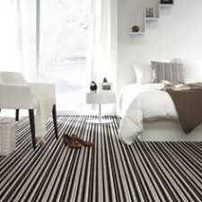 Modern Bedroom With Stylish Bed And Striped Carpet #bedroom #interior #style