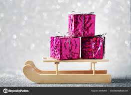 wooden toy sleigh gift boxes lights background stock photo