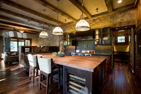 rustic kitchen design with modern mixed with vintage furniture and wide plank distressed wood flooring plus island with wine storage under pendant lamp plus