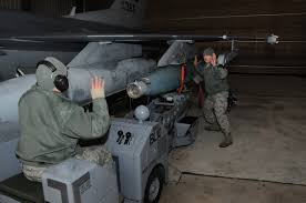 file u s air force senior airman kevin aguiar left operates a file u s air force senior airman kevin aguiar left operates a jammer in order to mount a gbu 12 paveway ii laser guided bomb onto an f 16c fighting