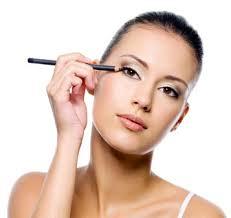 woman applying her makeup