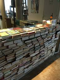 Ecomama Hotel: reception desk made of books - so cool! walkie talkies for  reaching