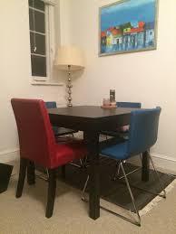 ikea bjursta extendable dining table and ikea bernhard chairs light used