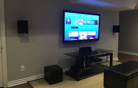 5 1ch home theater system installed with bookshelf speakers in a basement of a newer house speaker wires fished through walls ceiling