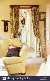 Patterned Curtains Living Room Cream Sofa In Cottage Living Room With Patterned Curtains On