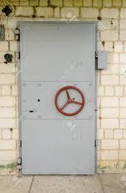 steel vault doors. Old Fashioned Reinforced Steel Vault Door With A Circular Red Handle Set Into Brick Wall Doors