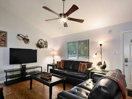 Interior : Delightful Home Living Room Interior Decor With Black Leather  Sofa Sets On Wooden Laminate Flororing Over Wooden Ceiling Lamp Also Music  Theme ...