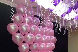 pink balloon decoration on wall for birthday