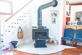 a simple rustic hearth design for a modern farmhouse look