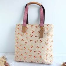 NWT F30604 Coach Tote Signature Jacquard Cherry Print Light Khaki Multi  Colored