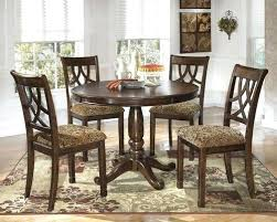 ashley charrell round dining table medium brown 6 4 upholstered