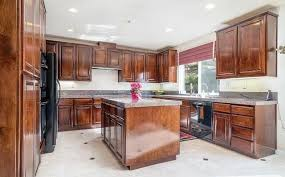 photo 7 of 42 island kitchen with cherry wood cabinets and granite countertops 3458