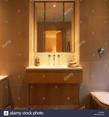 over bathroom cabinet lighting. Lighting And Mirror Above Basin In Vanity Unit Modern Bathroom Over Cabinet