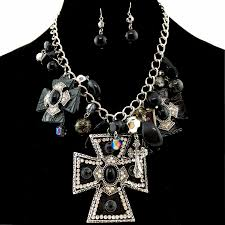 western black large cross pendant with charms necklace with pearl earrings
